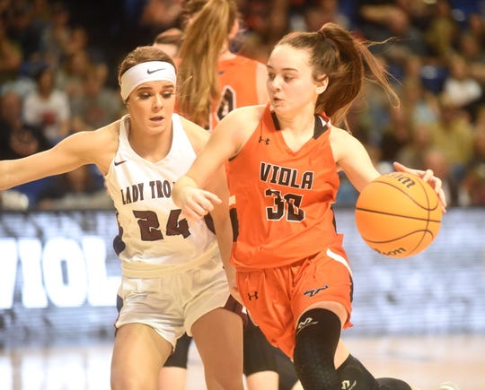 Viola's A.J. McCandlis is defended by Kirby's Kaylee Dougan on Thursday in the Class 1A State championship game.
