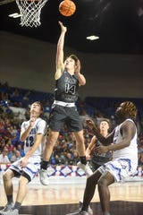 Izard County's Coby Everett puts up a shot against Nevada on Thursday.