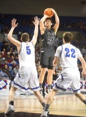 Izard County's Justus Cooper shoots a jumper against Nevada on Thursday afternoon.