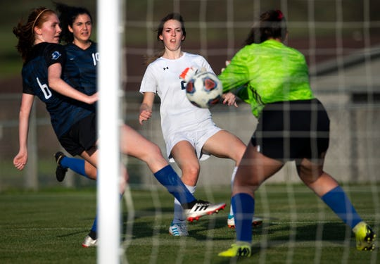 Trinity's Mary Alice Sasser (2) scores against Catholic at the Catholic campus in Montgomery, Ala., on Thursday March 12, 2020.