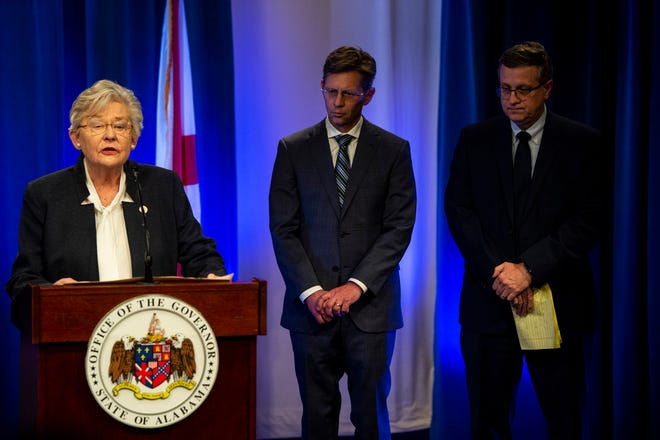 Gov. Kay Ivey speaks as State Superintendent Eric Mackey and Alabama State Health Officer Scott Harris wait to speak during a Covid-19 press conference at ADPH office in Montgomery, Ala., on Friday, March 13, 2020.