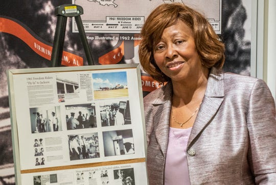 Kredelle Petway is shown at Montgomery's Freedom Rides museum on Thursday, March 12, 2020, next to a display about when she and her family were arrested as Freedom Riders who flew into Jackson, Mississippi's airport in 1961.