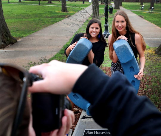 Missy Wood, left, and Kelsey Hughes have their senior pictures taken by fellow MTSU student Hannah Bowe near Peck Hall on Friday, March 13, 2020. Wood and Hughes are slated to graduate in May, but MTSU President Sidney McPhee said it is too early to know if concerns over the coronavirus will impact plans for graduation ceremonies this spring.