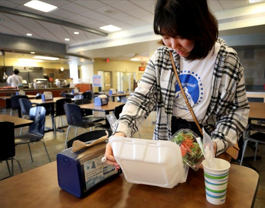 MTSU exchange student Gayeon Ko organizes her to-go meal at MTSU's McCallie Dining Hall on Friday, March 13, 2020.