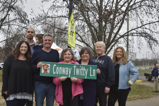 Conway Twitty's family members (from left) Kayla Slater, Marcus Slater, baby Zoe, Jimmy Twitty, Kathy (Twitty) Durante, Joni (Twitty) Ryles, John Ryles and Stacy Ryles, honor Conway Twitty at a ceremony Thursday, March 12 in Drakes Creek Park in Hendersonville, dedicating Conway Twitty Lane.