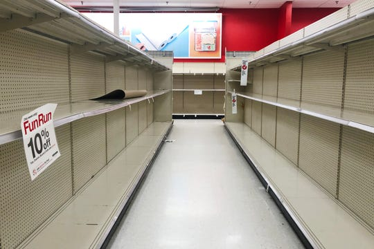 The toilet paper and paper towels shelves are left empty at Target off White Bridge Rd Friday, March 13, 2020, in Nashville, Tenn.