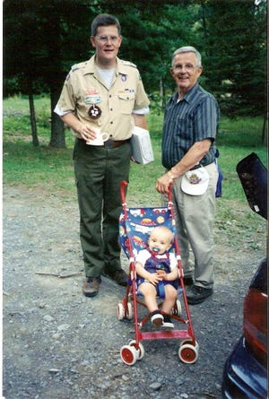 Jeff Gill, left, with his father, Ronald B. Gill, and son, Chris, in a 1999 family photo.