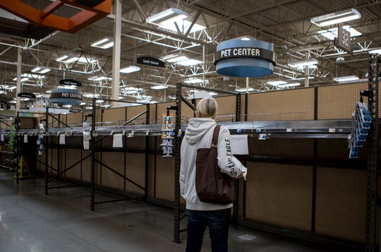 Anna Miracle looks in awe at the empty shelves of toilet paper at Kroger on 21st Street. Grocery stores are seeing a shortage on household items as people stock up in fear of being in self quarantine.