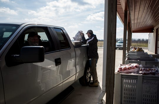 Cody Wilcox load the back of a truck at Lynds Fruit Farm. Lynds is now offering drive through service as a response to the Coronavirus. Their drive through will be open Fridays and Saturdays 9-4 until they run out of apples.