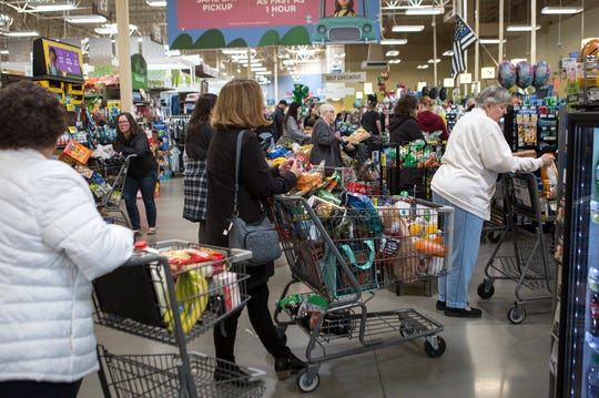 Shoppers pack the Kroger on 21st street buying items in lei of the Coronavirus and shutdowns coming.
