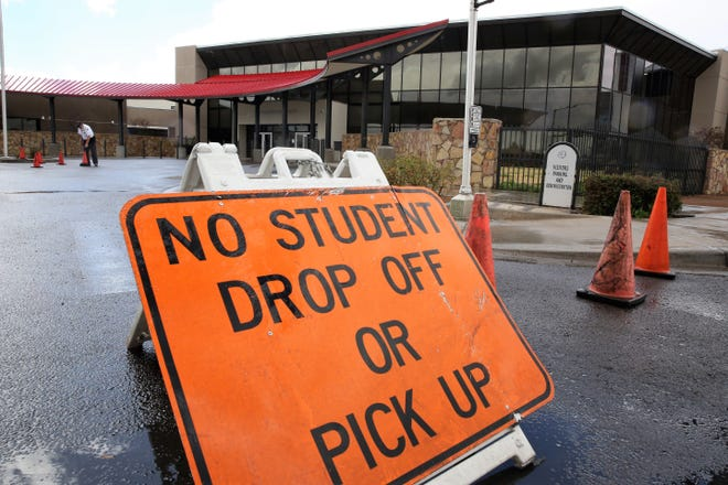 At Las Cruces High School cones block vehicle entry to the front of the school on Friday, March 13, 2020. It is the last day of school before a state-ordered three-week closure to help mitigate spread of the COVID-19 coronavirus pandemic.
