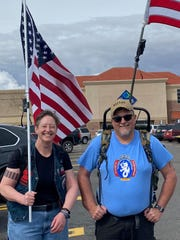 From left, Jennifer Foley and Kelly Oja, who had come to Las Cruces from Wisconsin to participate in the 31st Bataan Memorial Death March, outside a Sam's Club store on Thursday, March 12, 2020, where they purchased 80 pounds of canned food to donate to Casa de Peregrinos after the march was canceled.
