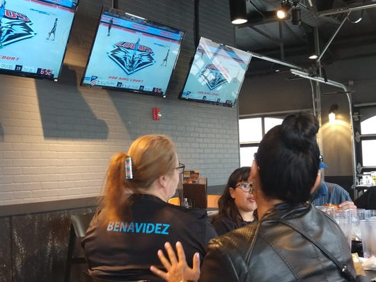 Las Cruces High boys basketball family members and supporters watch their team play at an Albuquerque restaurant following Thursday's state semifinal victory at The Pit as fans were banned due to coronavirus concerns.