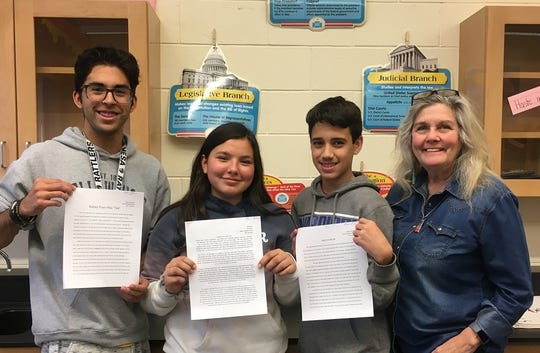 Among 45 entries, the winners were (left to right) Jose Daniel Figuerdo, Bethany Sanchez and Jacob Ormand. All are students of Ms. Michelle Senoski at Mesa Middle School.