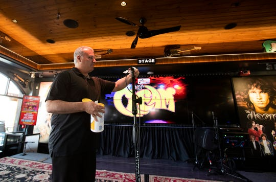 Jejj Mazur, sound engineer at Big Rock Pub wipes down microphones to be used by a band as a precaution against coronavirus. The sanitation of microphones is standard practice but more caution is being used these days.