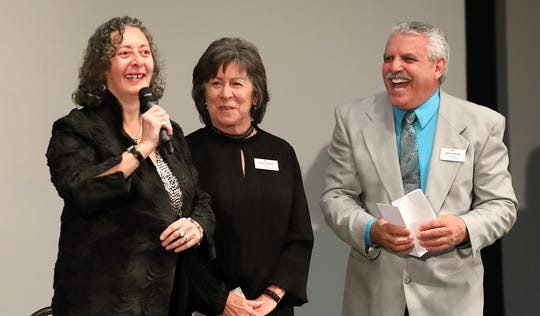"""Playwright Isabelle Sarfati talks about her play """"Broken Open,"""" following the recent premiere performance at UCR Palm Desert while Alzheimers Coachella Valley (ACV) board members Pat Kaplan and Dom Calvano, president, listen in. The play was a highlight of ACV's fundraising event."""