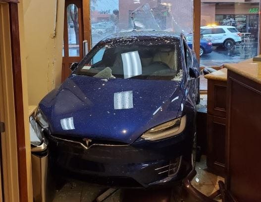 This photo shows a Tesla that crashed into a Palm Springs building at Sunrise Way and Ramon Road Thursday, March 12, 2020. Two people suffered minor injuries, firefighters say.