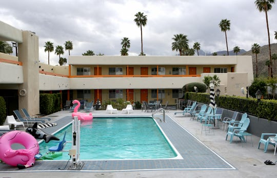 Pool floaties lay untouched at the Musicland Hotel in Palm Springs, Calif., on Friday, March 13, 2020. Musicland owners say occupancy is down by half due to events being canceled.