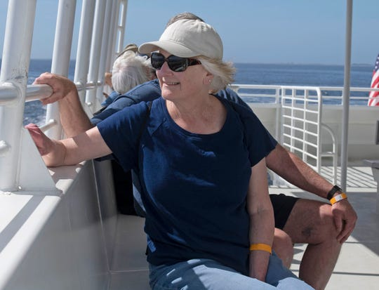 Terry Manck and her husband Dave enjoy a warm spring day sightseeing in Pensacola Bay aboard the Turtle Runner ferry operated by Pensacola Bay Cruises on Friday, March 13, 2020.