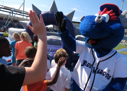 Pensacola Blue Wahoos mascot 'Kazoo' celebrates with staff and fans in an undated photo. The Blue Wahoos are going to provide financial support to seasonal staffers affected by the COVID-19 pandemic.