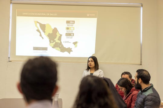 Health officials in Tijuana, Mexico, train workers on mitigating the spread of the new coronavirus.