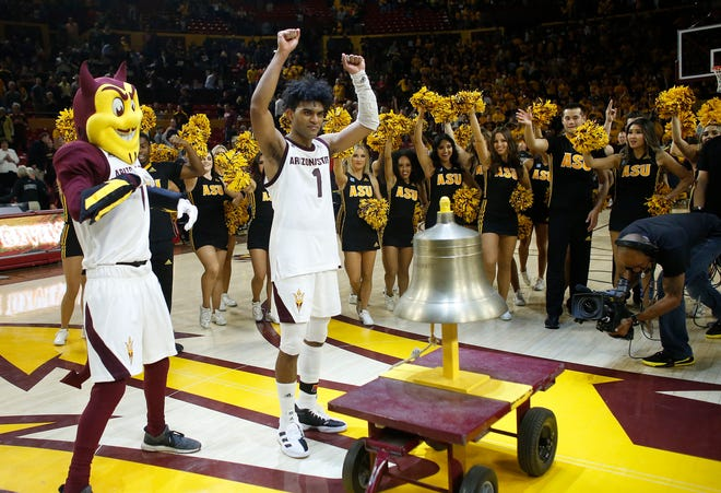 Arizona State Sun Devils guard Remy Martin (1) celebrates by rising the bell after beating the Arizona Wildcats 66-65 at Desert Financial Arena in Tempe, Ariz. on January 25, 2020.