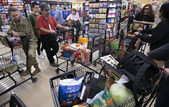 Long lines to check out at a Safeway grocery store in Phoenix on March 12, 2020.