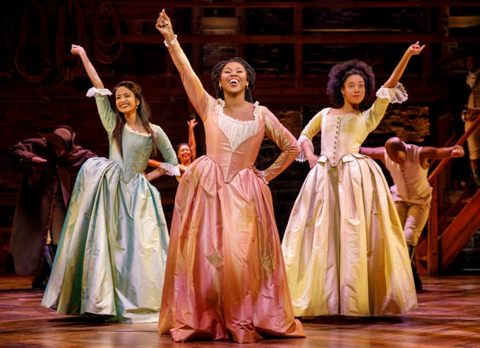 "Shoba Narayan, Ta'Rea Campbell and Danielle Sostre in ""Hamilton."""