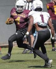 Freshman Daniyel Ngata (4) is among two new ASU running backs looking to replace Eno Benjamin.