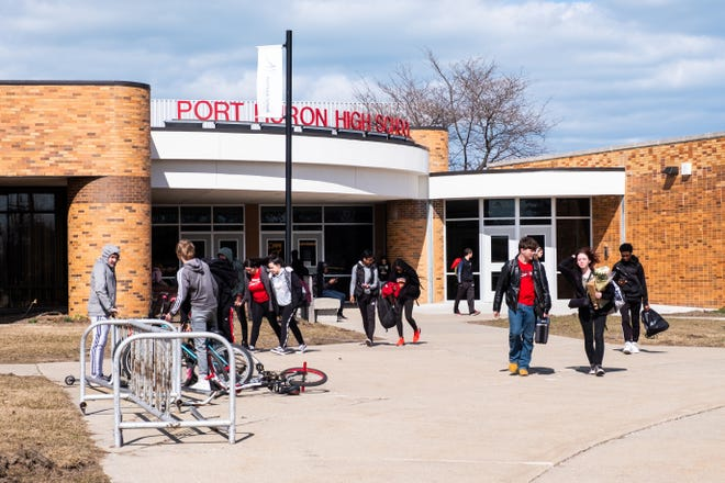 Students are released from Port Huron High School Friday, March 13, 2020, after Gov. Gretchen Whitmer ordered all K-12 schools in Michigan to be closed through April 5, before the decision was made to be closed for the rest of the school year. Port Huron Schools Superintendent Jamie Cain said they are working on three models of what school will look like next year.