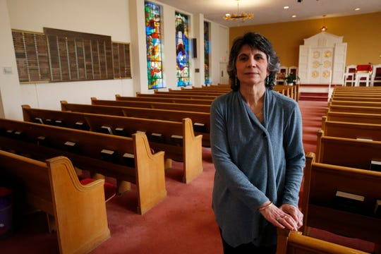 Rabbi Renni Altman inside the sanctuary of Vassar Temple in the City of Poughkeepsie on March 13, 2020. Typically Altman requests that congregants move closer together, but will instead suggest they spread throughout the sanctuary during Friday's shabbat service.