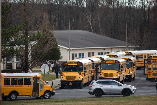 School buses line up at New Paltz High School during school dismissal in New Paltz on Friday. Dutchess, Ulster and Orange county schools will be closed for two weeks amid COVD-19 concerns. KELLY MARSH/FOR THE TIMES HERALD-RECORD