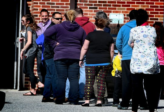 Parents and guardians gather to pick up students at New Salem Elementary School at the end of the school day Friday, March 13, 2020. Gov. Tom Wolf ordered Pennsylvania schools closed for 2 weeks starting Monday in an effort to contain the Cover-9 virus. Most York County Districts will be closed through March 30. Bill Kalina photo