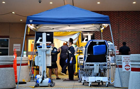A temporary patient screening and testing area, for the COVID-19 coronavirus, is shown outside the Emergency Department at WellSpan York Hospital in York City, Thursday, March 12, 2020. Dawn J. Sagert photo