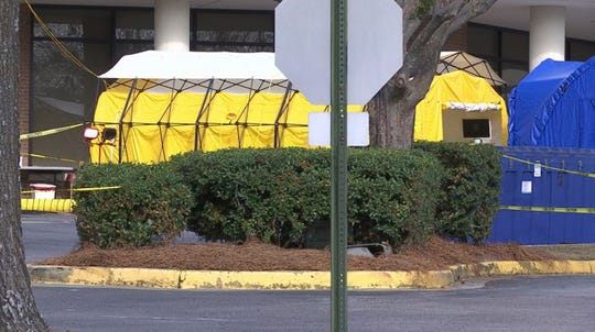 This Friday, March 13, 2020 photo shows tents set up outside the Lexington Medical Center hospital in West Columbia, S.C. U.S. hospitals are setting up tents for testing, canceling elective surgeries, calling on retired doctors for help and confronting the possibility they will have to ration treatment as they prepare for an expected onslaught of coronavirus patients. (AP Photo/Sarah Blake Morgan)