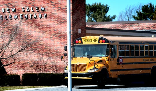 A bus awaits students at New Salem Elementary School at the end of the school day Friday, March 13, 2020. Gov. Tom Wolf ordered Pennsylvania schools closed for 2 weeks starting Monday in an effort to contain the Cover-9 virus. Most York County Districts will be closed through March 30. Bill Kalina photo