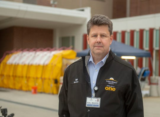 WellSpan Health Sr. Vice President Hal Baker stands in front of the outdoor coronavirus testing facility at York Hospital. Patients with symptoms of the virus will be screened there first.