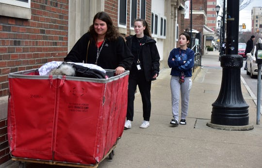 King's College Resident Assistant Sara Lucas helps Skyler Princi of Long Island and Amanda Nolan of Queens take their things to their car to leave campus on Thursday, March 12, 2020. The school will close until April 18 and students will use distance learning. The students said the virus didn't scare them but how they will learn was a worry. For most people, the new coronavirus causes only mild or moderate symptoms. For some it can cause more severe illness.