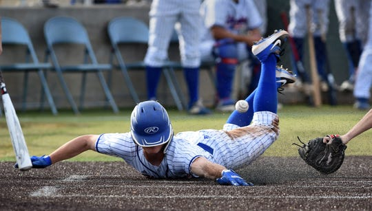 Reno's Coleman Schmidt slides into home plate against the Fernley Vaqueros during the 2020 Mike Bearman Memorial Tournament at Reno High.