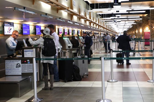 Passengers are seen at the Reno-Tahoe International Airport in Reno on March 13, 2020., 2019.