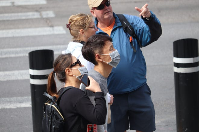 There were very fews masks on the Las Vegas Strip on Friday, March 13, 2020.