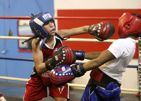 Javier Mitchell, 11, trains at the Fight Factory in Rochester.