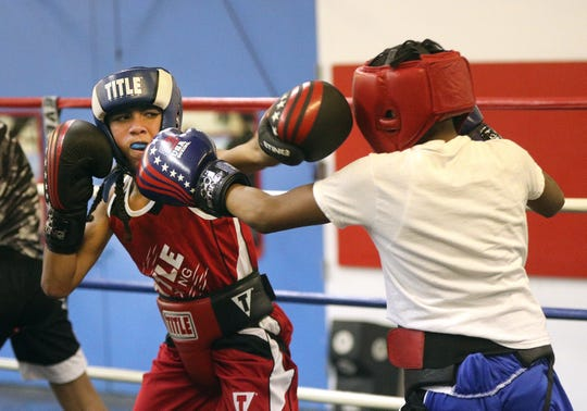 Javier Mitchell,11, says he loves training at the Fight Factory in Rochester.