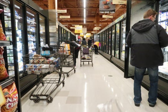 Pittsford Wegmans was busy with shoppers Thursday, March 12, 2020, hours after Rochester received news of its first positive confirmed coronavirus patient. Many people were stocking up on canned goods and other food items with longer shelf life.