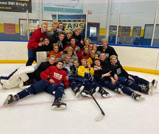 """Members of the Webster Thomas varsity hockey team gathered together for one more team photo on Thursday after learning that the state semifinals and finals had been """"indefinitely postponed."""""""