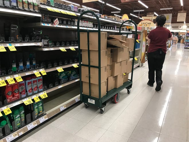 Pittsford Wegmans is slowly restocking the shelves on Friday, March 13, 2020, that were emptied Thursday.