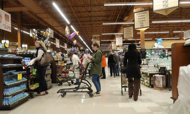 Pittsford Wegmans was busy with shoppers Thursday, March 12, 2020, hours after Rochester received news of its first positive COVID-19 patient.