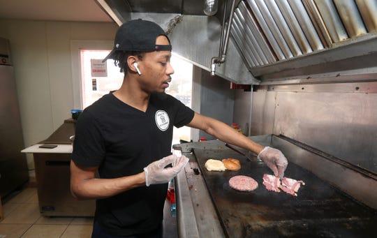 Zaaqi (Zoc) Johnson in his gourmet burger restaurant, Zoc's Gourmet, on Chili Avenue. Business has slowed amid the coronavirus outbreak.