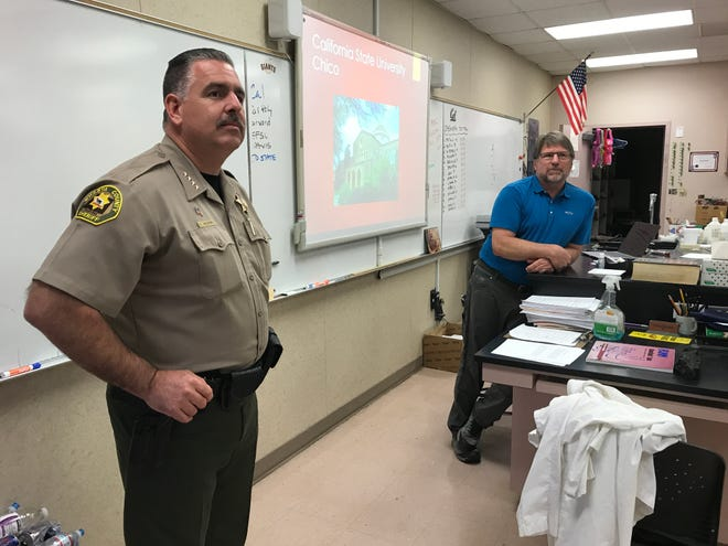 Shasta County Sheriff Eric Magrini talks to students in Dan Button's advanced placement biology class at West Valley High School on Wednesday, March 11, 2020. Magrini was on campus to serve as principal for the day.