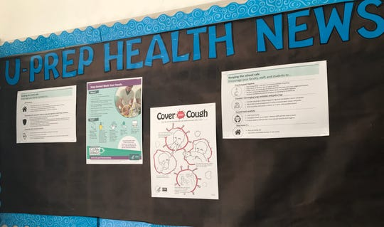 A U-Prep health news bulletin board gives students tips about hygiene and how to curb the spread of germs.